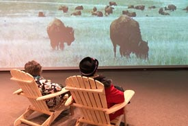 Enjoying the view at NCC's exhibit on Wideview at the Art Gallery of Regina. (Photo by Bill Armstrong)