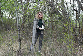 Picture of me as an intern in Alberta, rolling barbed wire at a Conservation Volunteers event (Photo by NCC)