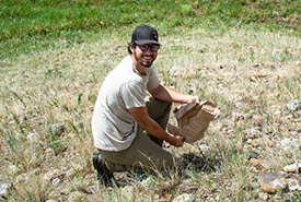 Conservation Intern Levi Williams Whitney cleaning up an NCC site (Photo by NCC)