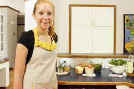 Maggie Cascadden making invasive species appetizers (Photo by Katie Cascadden)