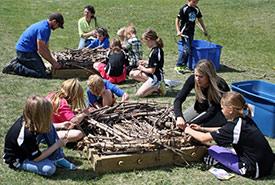 Students making ferruginous hawk nesting platforms. (Photo by Sandi Riemersma)