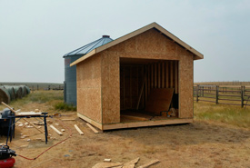 Making progress on the 12-foot by 16-foot shed, needed to store equipment and supplies. (Photo by NCC)