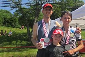 Scott McClennan, Sarah McClennan and Michael Ayerst pose together at the finish line (Photo courtesy of Sarah McClennan)