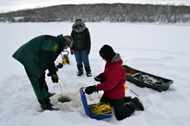 Measuring the diffused oxygen in the pond (Photo by NCC)