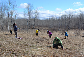 Conservation Volunteers planting trees at at the Meeting Lake 03 property, SK (Photo by NCC)