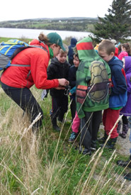 Megan Lafferty (NCC) showing students how the GPS marks where a nest box was installed (Photo by DUC)