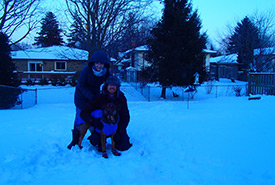 Me, my husband and dog bundled up during the polar vortex (Photo courtesy of Meghan Duell)