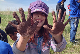 Muddy hands at Nature Days (photo by NCC)