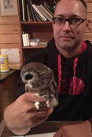 Ian Fife with saw whet owl (Photo courtesy of Ian Fife)