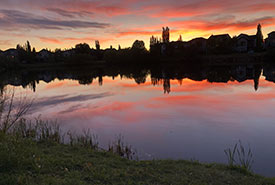 The reflection of Inverness pond at sunset (Photo by Christine Beevis Trickett/NCC staff)