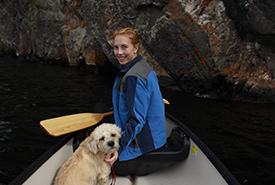 Raechel Bonomo and her trusty sidekick, Sprout, on Mazinaw Lake, ON (Photo courtesy of Raechel Bonomo/NCC staff)