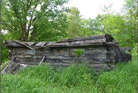 Remnants of the log barn (Photo by NCC)