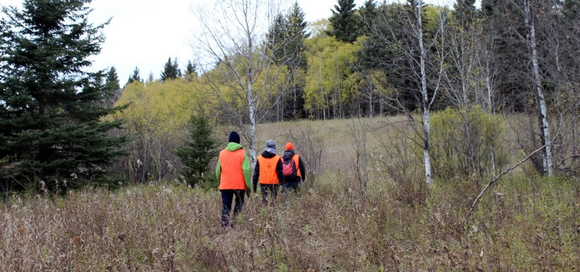 Our hike included a visit to recently restored wetlands, a meander through mixed wood forest and a discussion about forest and grassland restoration. (Photo by NCC)