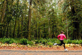 Running in nature has many proven benefits. (Photo from Masterfile)