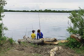 Maddy and Finn fishing by the shore (Photo by Amy Sanderson)