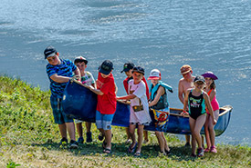 Lifting the canoe is easier with two or more people. (Photo by Blake Edwards)