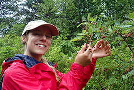 Me checking serviceberries for ripeness (Photo by NCC)