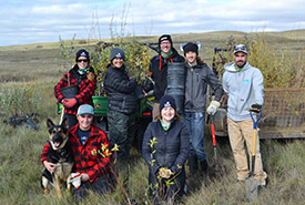 Six staffers and volunteers, 200 shrubs, five hours. Team work really does make the dream work. (Photo by NCC)