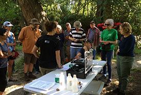 Stewardship volunteers listen to Regional District of Nanaimo staff describe how to use water quality monitoring equipment, at an annual training session to empower community members to collect data on their local creeks and streams as part of the RDN Community Watershed Monitoring Network. (Photo by Regional District of Nanaimo)