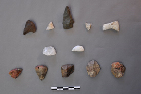 Stone tools recovered from the excavation. Arrow and spear points can be seen on the top row, while scrapers (for working wood and hides) can be seen on the bottom two rows. (Photo by Matthew Betts/Canadian Museum of History)
