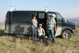 The crew at Shoderee Ranch at Waterton, with the trusty van. (L-R) - Director of Photography - Ann Tipper, Producer - Yvonne Drebert, Director - Zach Melnick (Photo by Larry Drebert)