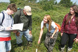 Student volunteers with the Gulf of Maine Institute help monitor water levels (Photo by NCC)