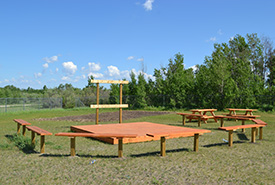 The Asiniw-Kisik Education Campus on Kawacatoose First Nation built an outdoor theatre and presentation space and created a garden plot. (Photo by NCC)