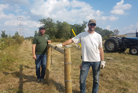 Tim Teetaert and Stephen Gietz installing fences at the Manitoba Tall Grass Prairie Preserve (Photo by NCC)