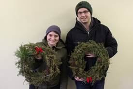 Volunteers proudly displaying their wreaths (Photo by NCC)