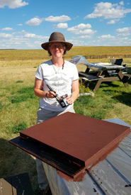 A volunteer with a nearly finished bat box. (Photo by NCC)
