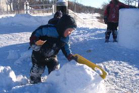 Child carving snow (Photo by Jodine Pratt/NCC)