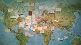 A map with the business cards from the home-countries of the delegates. (Photo by NCC)