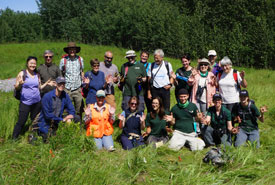 NCC volunteers and staff cap off the day with a silly jazz hands group photo. (Photo by NCC)