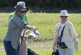 Volunteer throwing seed bombs into experimental test plot at Conservation Volunteers event in Alberta. (Photo by NCC)