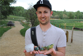 Steven Siffledeen learns about amphibian life cycles at Bunchberry Meadows CV event (Photo by NCC)