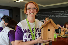 Telus employee showing off her finished bird box (Photo by NCC)