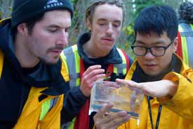 BCIT students inspect a sample from Centre Creek (Photo by NCC)