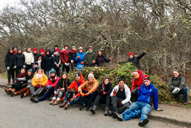 Volunteers with ivy pile at Uplands Park (Photo by Wylie Thomas)