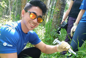 Volunteer measures tree root collar diameter with calliper. (Photo by NCC)