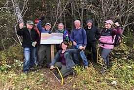Conservation Volunteers at a trail maintenance event at the Five Fathom Hole Trail at the Musquash Estuary Nature Reserve, New Brunswick (Photo by NCC).