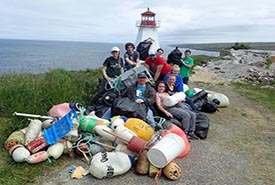 Conservation Volunteers with the marine debris that they removed from the Boar's Head Nature Reserve, Nova Scotia (Photo by NCC).