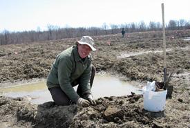 Volunteer for Nature volunteer John Larose on Clear Creek, ON. 2003 (Photo by Bronwen Smith)