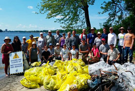 Volunteers clear debris from Kettle Island (Photo by NCC)