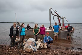 Volunteers with the marine debris they removed, Thomas Island, PEI (Photo by Stephen DesRoches).