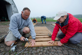 Conservation Volunteers John and Ray working on a boardwalk as a part of the