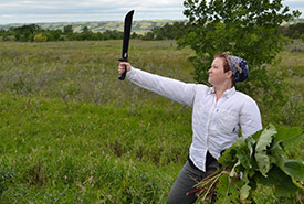 Conservation Volunteer ready to tackle common burdock (Photo by NCC)
