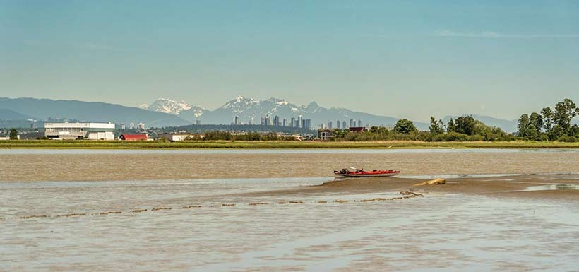 Kayaks are the best way to explore the area. Swishwash Island and the city of Richmond in the background. (Photo by Fernando Lessa)