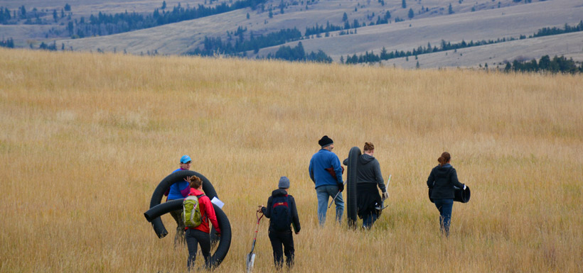 Volunteers carry supplies out to various sites on Napier Lake Ranch Conservation Area, BA (Photo by NCC)