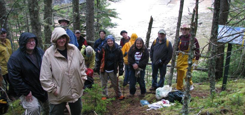 Rain or shine, CVs work toward conservation. Musquash, NB '10 (Photo by NCC)