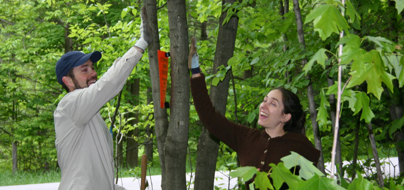 High-fiving after a great tree planting event in QC! '13 (Photo by NCC)